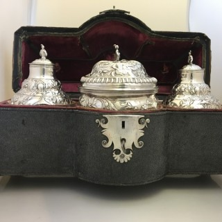 A  George III shagreen cased tea caddies and sugar bowl by Samuel Taylor.