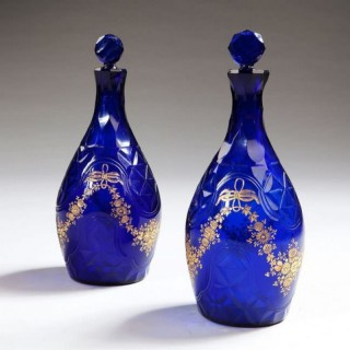 PAIR OF BLUE GLASS FACET CUT DECANTERS