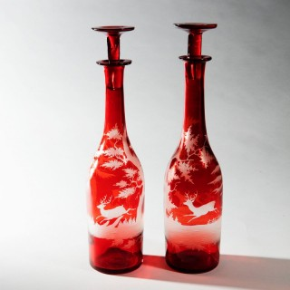 PAIR OF WHEEL ENGRAVED BOHEMIAN RUBY FLASH HUNTING BOTTLES AND STOPPERS