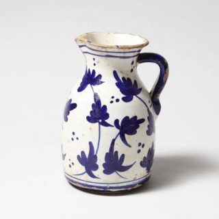 BLUE AND WHITE POTTERY JUG