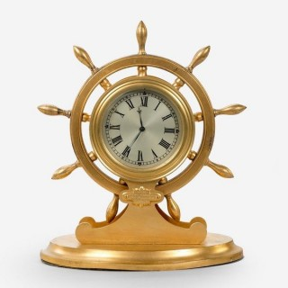English gilt metal ship's wheel desk clock