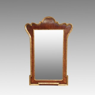 Geo I style walnut and carved giltwood  mirror.