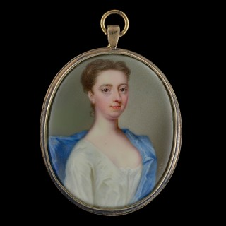 A portrait of a lady, wearing a white dress and blue cape