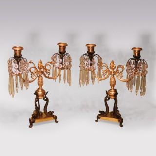 Pair Regency bronze and ormolu 2-light lustre candlesticks