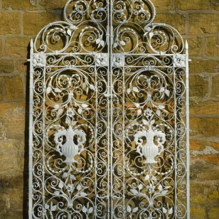 A pair of ornate wrought iron garden gates