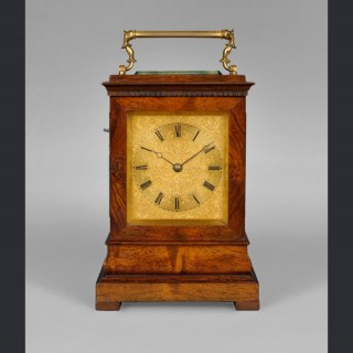 A rare mid nineteenth century travelling clock by  McMaster & Son Dublin. No. 3674