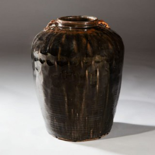 A DARK GLAZED SOUTH CHINA STORAGE JAR
