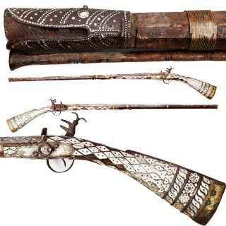 A 18TH CENTURY OTTOMAN EMPIRE MOTHER OF PEARL MIQUELET GUN