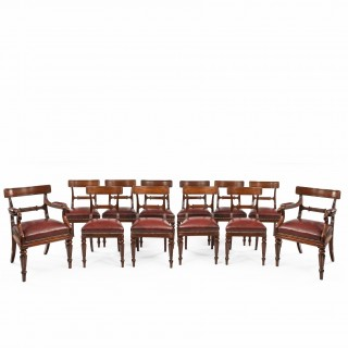 A fine set of 12 Gillows mahogany dining chairs (England, 1820)