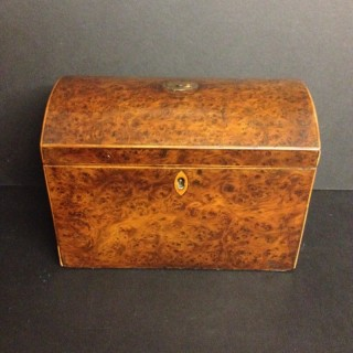 Georgian burr yew tea caddy.