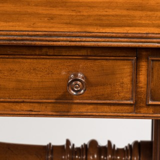 A Regency end support mahogany sofa table