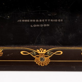 A fine mid-Victorian papier maché box by Jennens & Bettridge with a silver medallion by Pinches