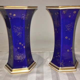 A pair of Royal Crown Derby porcelain vases