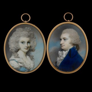 Portrait of Mr & Mrs Graham of Fintry (probably Robert and Margaret Graham of Fintry); he wears a blue coat, white cravat and powdered wig; she wears a white chemise and blue bodice, her hair powdered grey, c.1785