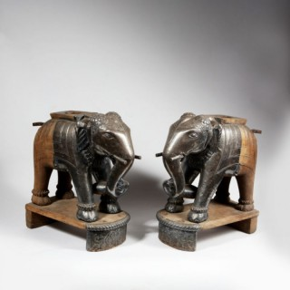 A PAIR OF SILVERED ARCHITECTURAL TEAK ELEPHANTS