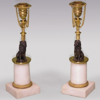 Pair of 19th Century bronze ormolu and marble Lion Candlesticks.