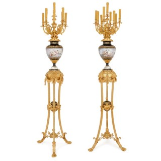 Pair of Sevres style porcelain and gilt bronze floor standing lamps