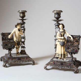 PAIR OF ROCK CRYSTAL, IVORY AND SILVER GILT FIGURAL CANDLESTICKS