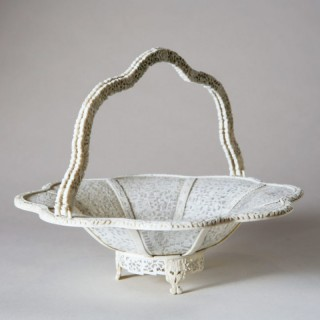 CHINESE TWO HANDLED CARVED IVORY OPEN BASKET