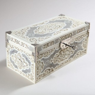 CHINESE CARVED AND PIERCED IVORY RECTANGULAR TEA CHEST