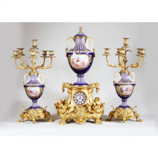 A NAPOLEON III ORMOLU AND SEVRES STYLE PORCELAIN CLOCK GARNITURE