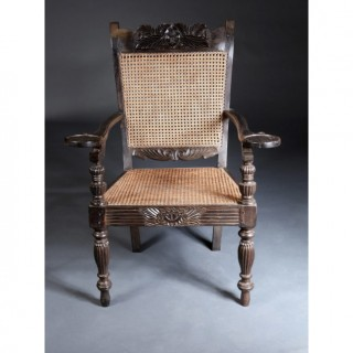 PAIR OF LARGE SCALE CEYLONESE SOLID EBONY ARMCHAIRS