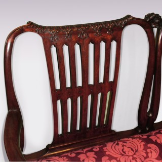 A mid 18th century carved mahogany 2-seater Settee.