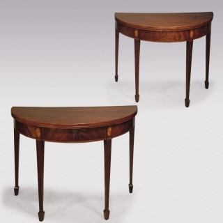 A pair of Sheraton period half-round figured mahogany Tea Tables.