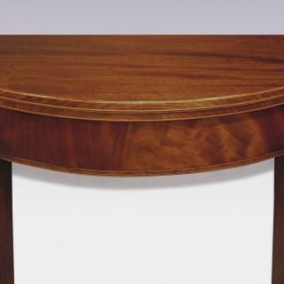 A pair of Sheraton period half-round figured mahogany Tea Tables.