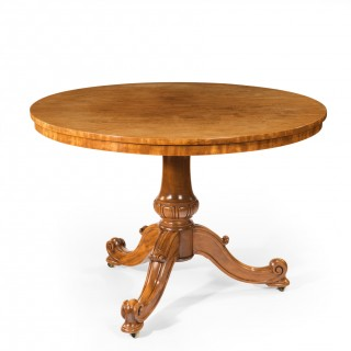 A mid-Victorian faded satinwood centre table