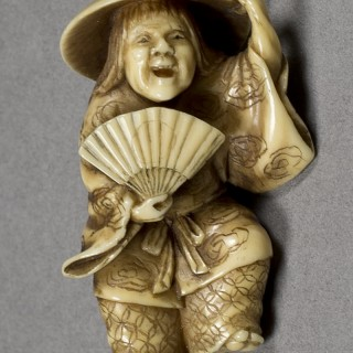 JAPANESE MEIJI PERIOD IVORY NETSUKE OF A DANCING SHOJO-SIGNED