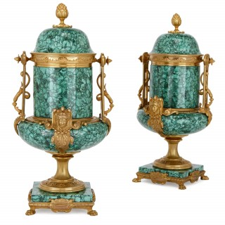 Pair of malachite and gilt bronze lidded urns