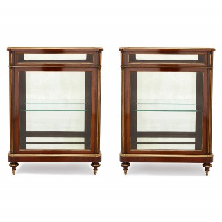 Two glass and mahogany display cabinets, 19th Century France