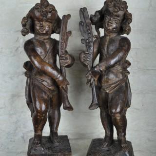 Pair of 17th century Oak Putti