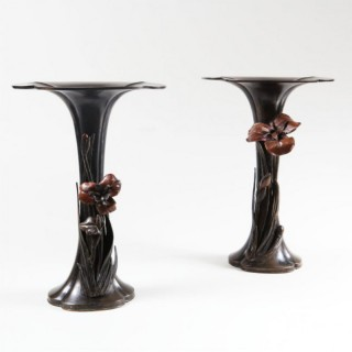 A PAIR OF BRONZE TRUMPET VASES WITH HIGH RELIEF FLOWERS