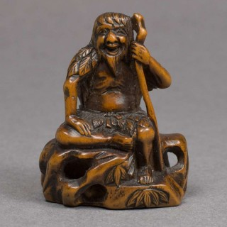 JAPANESE MEIJI PERIOD BOXWOOD NETSUKE OF A SEATED SENNIN - SIGNED