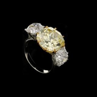 Hancocks Old Mine Cut Fancy Intense Yellow Diamond and Diamond Three Stone Ring