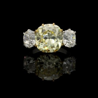 Hancocks Old Mine Cut Fancy Intense Yellow Diamond and Diamond Three Stone Ring