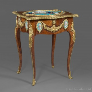 A Louis XV Style Gilt-Bronze Mounted and Porcelain Set Table
