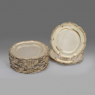 A Set of Twenty-Four Silver-Gilt Plates by Hunt & Roskell