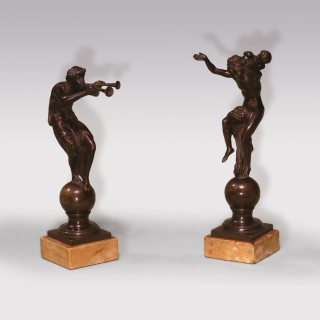 Pair of well cast bronze satyric figures
