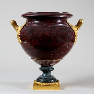 A ROUGE GRIOTTE MARBLE AND GREEN MARBLE URN WITH ORMOLU MOUNTS