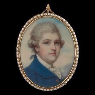 A Gentleman, wearing a blue coat, white jabot and powdered hair en queue, c. 1785