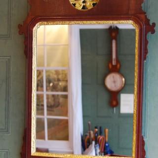 George III Period Mahogany and parcel gilt fretwork wall mirror