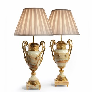 An impressive pair of French onyx and ormolu lamps