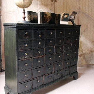 A 19thC Painted Pine Bank of Thirty-Six Drawers c.1870