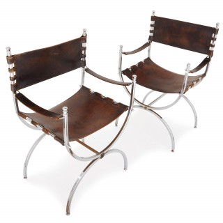 Set of two Mid Century Modern silvered and leather chairs