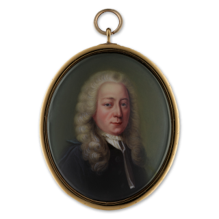 A portrait enamel of a professional, probably a lawyer, wearing black robes over white lawn bands and a small frill collar, c.1730