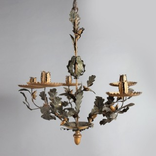 A most unusual mid 19th century tôle and giltwood oak leaf five branch chandelier