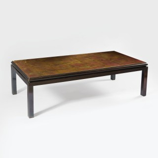 A low table in gun metal by Guy Lefevre for Maison Jansen